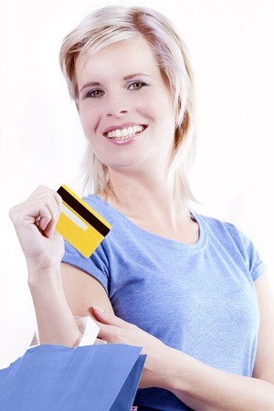 Credit cards and shopping bags holding the hand of a woman  photo