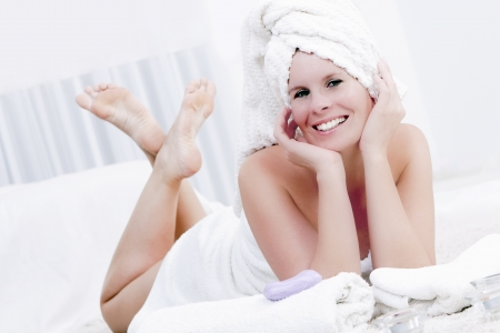 Attractive woman is relaxing in the wellness  photo