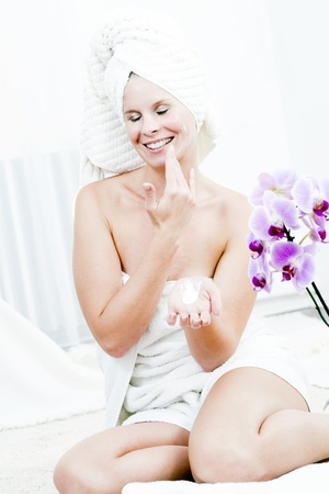 Young pleasure woman is body care in the spa  photo