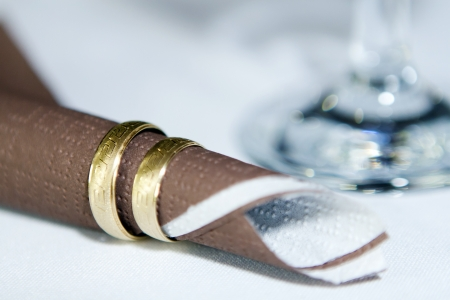 A pair of gold rings napkins, festive stake  photo