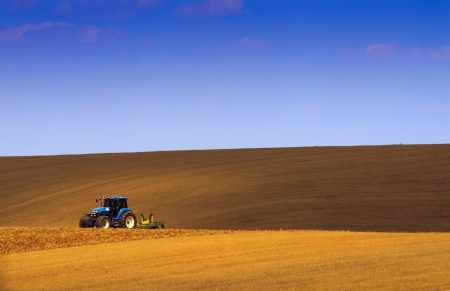 A tractor working in the field  photo