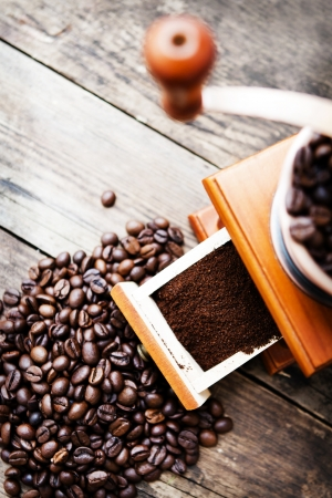 Roasted coffee beans and coffee grinder  photo
