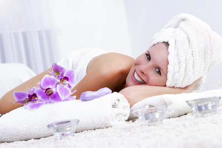 Attractive girl enjoying the skin care  photo