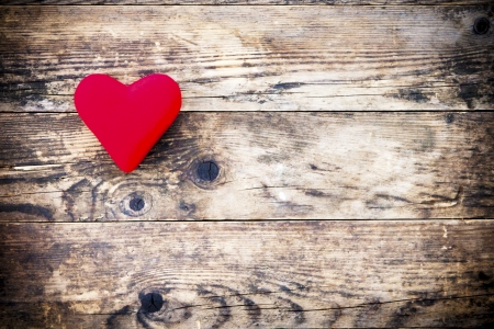 Red heart symbol on a rustic wooden planks  photo