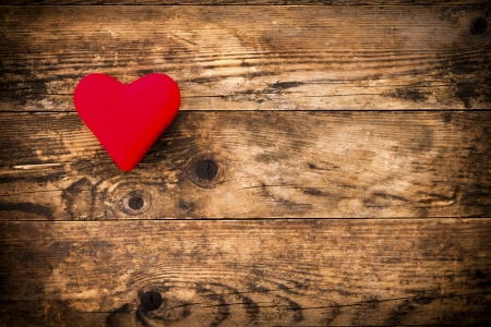 Wood background with red heart and nothing else  photo
