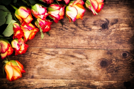 Roses on a rustic wooden table  photo