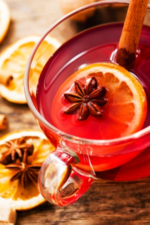 Glass cup of tea in it and anise orange and cinnamon  photo