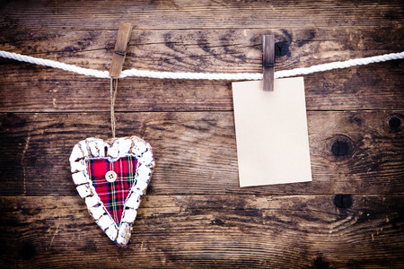 The rustic wood background with heart symbol, and note  photo
