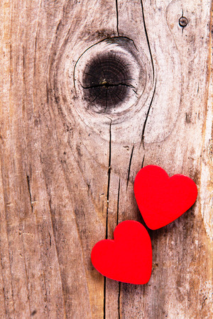 Rustic wooden background with red heart symbol  photo