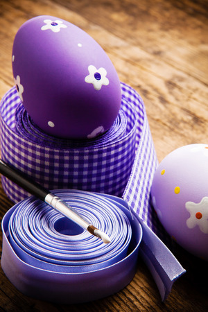 The wooden background decorated Easter eggs  photo