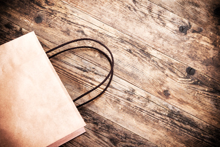 paperbag: Paper bag rustic wooden background.