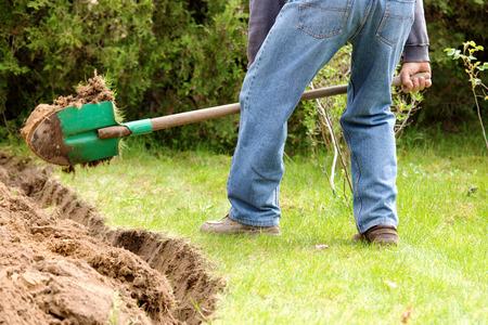 A man digging in the garden soil  Reklamní fotografie