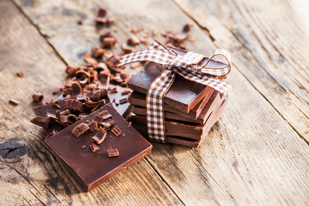 Pieces of chocolate bow wooden board.