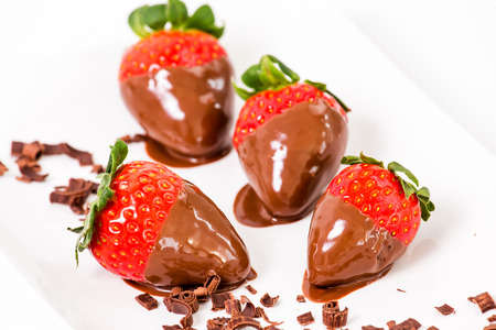 Ripe strawberries dipped in chocolate. photo