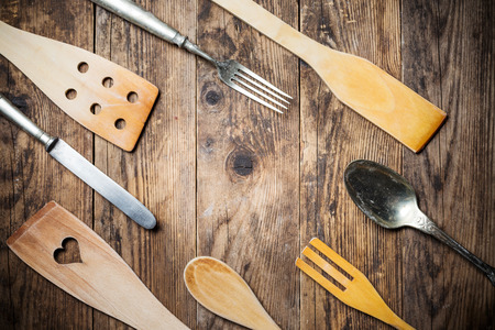 grunge flatware: Old kitchen appliances, wood table.