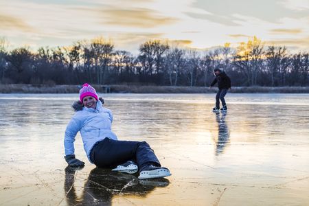 Women's ice skate on the lake. photo