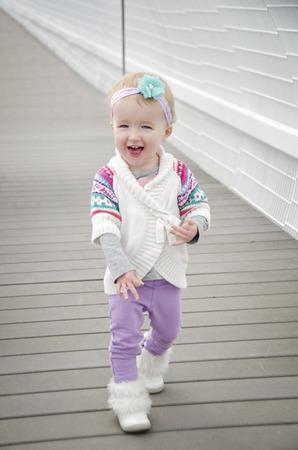 toddler walking: cute little toddler walking along