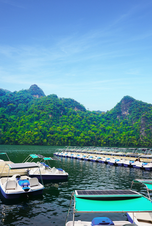geoforest: boats on Island of the Pregnant Maiden lake, langkawi, malaysia, Marble Geoforest Park