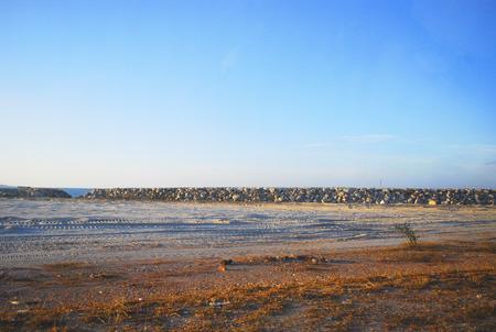 dikes: Sea dikes with sea and sky