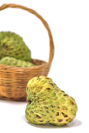 scaly custard apple: a basket of custard apple in the white background