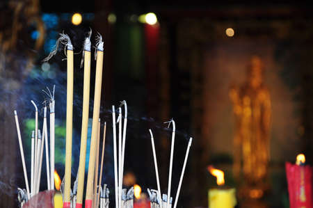blessing and pray with joss stick in the chinese pagoda photo