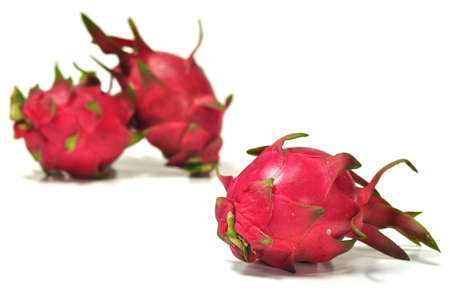 The fresh beautiful dragon fruits in the white background photo