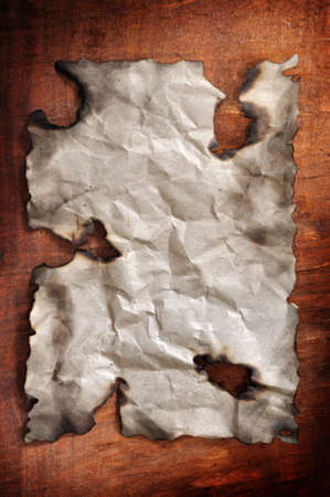 burned paper was placed on the wooden board for designs Stock Photo