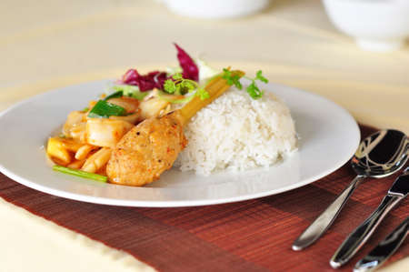 mince pork or shrimp and cover the lemon grass cooked with sweet and sour ingredient and served with rice -- vietnamese food
