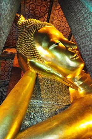 the golden lying buddha in Wat Pho, bangkok thailand photo