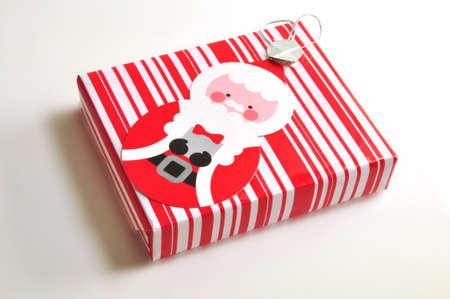 a xmas gift box with santa clause on the box Stock Photo