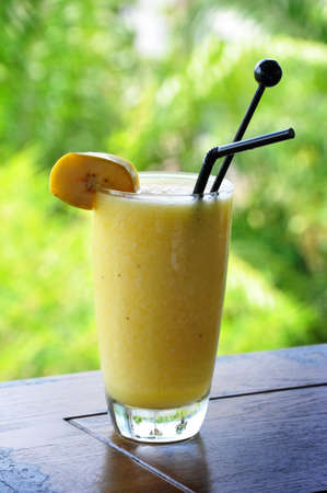 eating banana: the mixed of fruit smoothie mocktail named banana paradise Stock Photo