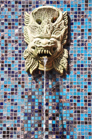 the Lion fountain on the wall slitting out water photo