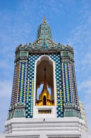 golden bell tower at the emerlad buddha temple - bangkok , thailand photo