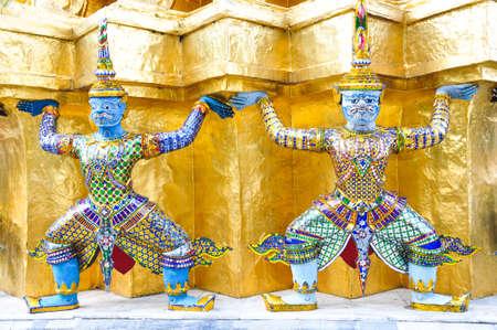 thai demon sculptures in the Emerald Buddha temple - Bangkok, thailand