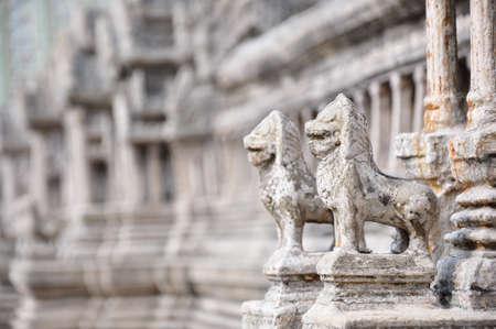 the couple of stone gardian lion at the Emerald Buddha Templa, Bankok - Thailand Stock Photo