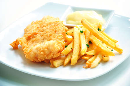 Fish and chips served with mayo photo