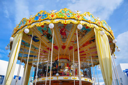 Colourful carnival Horses on a merry-go-round carousel Stock Photo