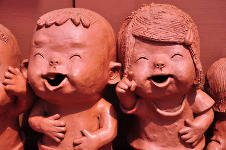clay craft: The baked clay doll, handmade sculpture from Thailand Stock Photo