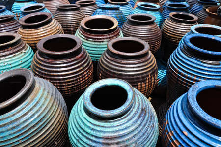 The water containers or clay jar with a uniqhe design from Thailand Stock Photo
