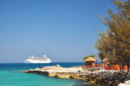 The view of cruise and hut at Coco Cay, Bahamas