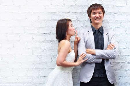A bride telld a groom to keep quiet