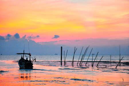 A fisherman sailing his boat during morning Stock Photo