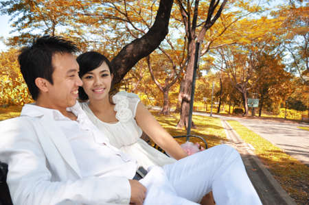 Married couple romantically sitting in a park Stock Photo