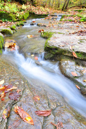The peacful waterfall in the begining of fall season