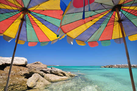 The twin umbrella with beautiful beach and clear sky