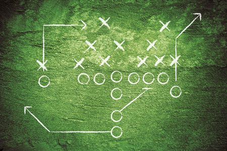 Grunge football play with chalk drawn lines.