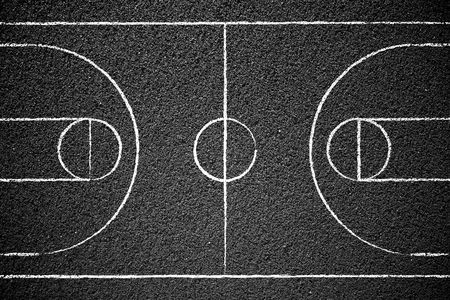 Street basketball court with chalk drawn lines.