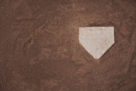 High vantage point of home plate on a baseball field.