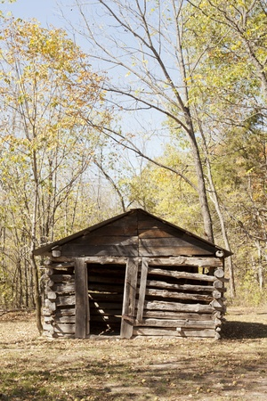 Front side of an old cabin built in the ozark mountains.