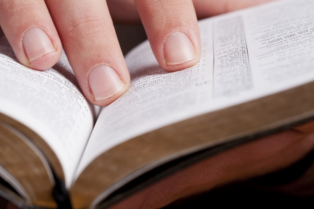 read bible: Close photo of man thumbing through the Bible. Macro.